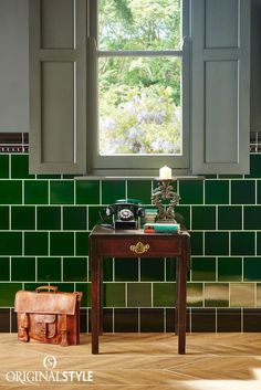 Wall tiles from Original Style, Artworks Range, Victorian Green Field Tile. Intense and rich, Victorian Green is a stunning legacy from the Victorians. Stunning colour and a translucent glazes creates luxury in any interior setting. Add bold skirtings and moldings in black to create an attractive transition between surfaces in your bathroom or kitchen.
