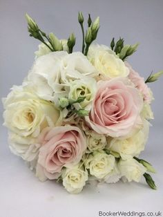 Gorgeous white and pink Bridesmaid bouquet of roses, spray roses, lisianthus and hydreangeas from Liverpool Bridal Florist, Booker Flowers and Gifts #weddingflowers #whitewedding #weddingflorist #liverpoolflorist