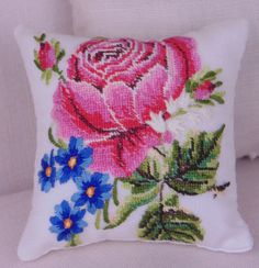 1:6 scale pillow for fashion dolls, hand sewn from a vintage hankie. Hand embroidery and exquisite petit point adorn the front of the pillow. Back of