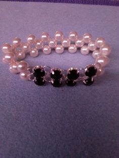 Pearl and black stone bracelet