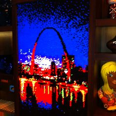 More amazing Lite Brite art by Rob Surette - this time it's that famous arch from Andy's home town, St. Louis. (Wish you could see these in person. They are incredible. Hard not to stare at them!)