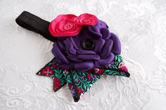 Orchid Rose Headband. $12.00, via Etsy.