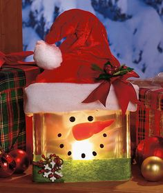lighted glass snowman - I thought I was over the glass blocks, but now I can upcycle with this cute idea. Decoration Christmas, Decoration Table, Christmas Snowman, Winter Christmas, Christmas Holidays, Christmas Ornaments, Christmas Wood, Holiday Decorating, Snowman Crafts