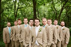Tan suits. Mint ties, etc not blue! I like the idea of the groom wearing all white.