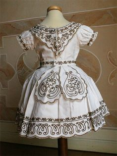 Child's dress in white cotton with belt, 1862, by Abiti Antichi.