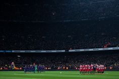 FC Barcelona and Girona FC players hold a minute of silence in memory of the Basque policeman who died during clashes outside San Mames stadium in Bilbao on Thursday in the UEFA Europa League match between Club Athletic and Spartak Moscow before the La Liga match between Barcelona and Girona at Camp Nou on February 24, 2018 in Barcelona.