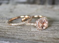 Morganite Ring Set in 14K Rose Gold Halo Diamond Setting. Stunning and unique.....this is definitely what I want my wedding ring to look like!