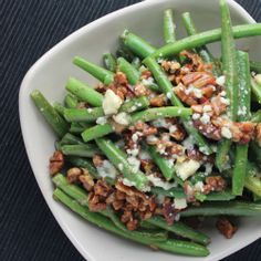Bacon, blue cheese and candied pecans are tossed with fresh green beans for a sweet and salty vegetable side dish.
