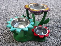 MEADOW BOUQUET This free standing pet bowl stand is carefully handcrafted to details. The height of different stands is 10, 20 and 30 cm. Bowl diameter is (1X) 14 cm, (1X) 18cm and (1X) 22 cm . Quality stainless steel bowl is dishwasher safe.  Production method: This pet bowl stand is hand made, cut out of wood and painted with stain water based color (perfect for toys).  Materials: bowl: stainless steel stand: wood (beech)