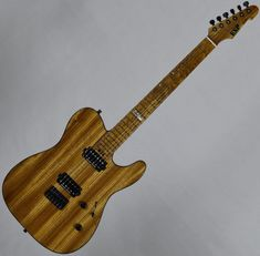 It features a quarter-sawn thin U-shaped maple neck that's paired with an amazing roasted birdseye maple fingerboard. LV Guitars - Electric Guitar, Bass and Acoustic. Acoustic Guitar Strap, Esp Guitars, Guitar Hanger, Birdseye Maple, Seymour Duncan, Studio Gear, North Hollywood, Led Night Light, Cool Guitar