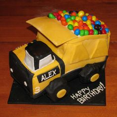 Dump truck cake! Love this one! Maybe use a little blue & green somewhere to brighten it up a bit!