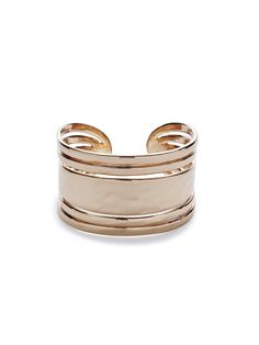 Glamour's style ambassador, Lana Russo, recommends this rose gold cuff as a go-to accessory for fall.