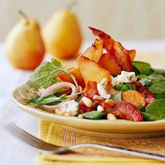 Arugula and Pear Salad | Peppery arugula teams up with creamy Gorgonzola and sweet pears for a beautiful start to a stylish dinner party. Hint: Be sure to cook the pancetta or bacon till crispy.
