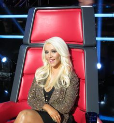 Christina Aguilera in black Alexander Wang dress with a gold sequin Jay Ahr jacket. The Voice S2 (May 8, 2012)