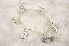 Silver Charm Bracelet with Cupid and Winged Hearts Love Theme Rhodium and Pewter by Jewelsbyjackiecom on Etsy