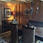 Dining room with barnwood interior and rough-sawn beams