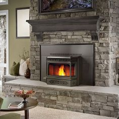 Stone fireplace surround with hearth stones and rustic wood mantle. Probably my fave brick fireplace I've seen. Now if only I can convince the man of the house to say goodbye to that ugly stone on the fireplace Pellet Stove Fireplace Insert, Pellet Stove Inserts, Wood Burning Insert, Wood Pellet Stoves, Wood Burning Fireplace Inserts, Wood Insert, Grey Stone Fireplace, Hearth Stone, Ovens