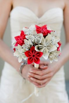 paper flowers; this would be cute to do with love notes from the groom, the groom can where flower made with note from bride. Doing this!