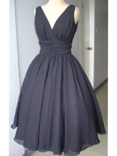 Black chiffon 50s style cocktail dress. Classic two strap, V neck with fine ruching and thick waistband. Simple and elegant