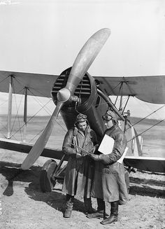 "A pilot and observer in front of a RAF Bristol F.2 ""Fighter"" aircraft"