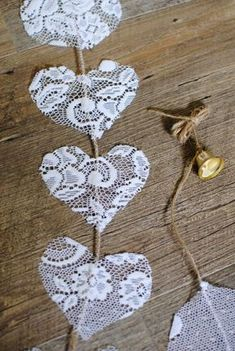 Items similar to Vertical lace hearts on a jute cord, with a gold coloured bell. Suitable to decorate wedding and party venues. on Etsy Vertical lace hearts on a jute cord, with a gold coloured bell. Suitable to decorate wedding and party venues. Wedding Crafts, Diy Wedding, Rustic Wedding, Wedding Decorations, Wedding Lace, Wedding Things, Wedding Bells, Country Wedding Centerpieces, Wedding Reception