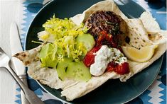 Middle Eastern lamb burger with minted yogurt and hot tomato sauce recipe A delicious spiced lamb burger served in flatbread with cooling yogurt and a piquant tomato sauce Burger Places, Lamb Burgers, Tomato Sauce Recipe, Yogurt, Nom Nom, Spices, Ethnic Recipes, African Recipes, Mint