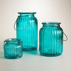 Teal Ribbed Glass Lantern Candleholder, World Market. I would like these to go with my turquoise chairs and to put Citronella in!