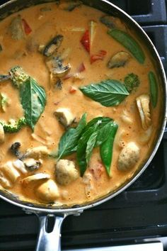 Vegan Thai Panang Curry with coconut milk, mushrooms, snap peas, red bell peppers, and basil