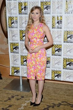 Superhero Style: See What All the Celebs Wore to Comic-Con: Hailee Steinfeld got an eyeful of a look out of the Fall 2013 Kenzo dress she wore to a press preview for Ender's Game. : Scarlett Johansson wore a pink-and-yellow floral-print Versace dress at a press event for Marvel Studios.