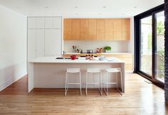 white with light wood, full ceiling, interesting to use tile under the island. la Shed—skip down to Lavoie