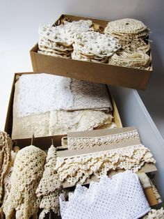 Storing lace in brown paper boxes... Beautiful idea, frugal, too.