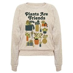 """This Plants Are Friends retro inspired shirt is perfect for anyone who is a fan of houseplants and 1970's graphic design. This succulent shirt features an illustration of a variety of succulents in different patterned pots along with the phrase """"Plants Are Friends."""""""