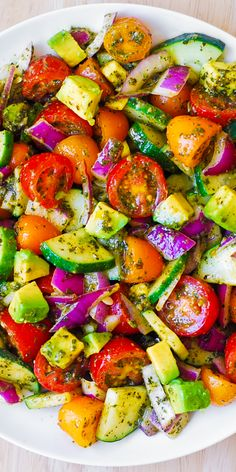 mediterranean recipes Spring Salad with Tomatoes, Cucumber, Avocado, and Basil Pesto. This healthy, Mediterranean recipe features lots of fresh vegetables. This recipe uses ju Avocado Recipes, Healthy Salad Recipes, Vegetarian Recipes, Cooking Recipes, Vegetable Salad Recipes, Vegetable Soups, Fresh Basil Recipes, Zucchini Pasta Recipes, Cherry Tomato Recipes
