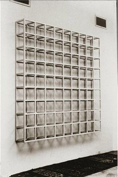 Sol LeWitt introduced the term Conceptual Art to explain the use of seriality and systemic structure in his cubic grid-like forms