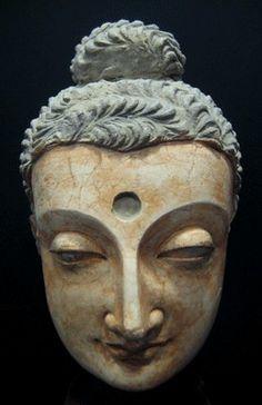 "Large Polychromed Buddha Head - TF.004 Origin: Central Asia Circa: 100 AD to 400 AD Dimensions: 14.25"" (36.2cm) high x 8"" (20.3cm) wide Collection: Asian Art Medium: Stucco"