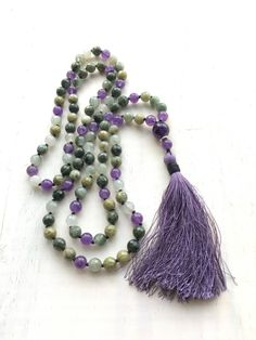 Calm your fears and soothe the mind with the Amethyst and Quartz Mala from True Nature Jewelry. Custom handcrafted in stunning detail, it features soothing Amethyst beads sprinkled throughout the Mala along with the power of Quartz which is associated with the Root Chakra and is