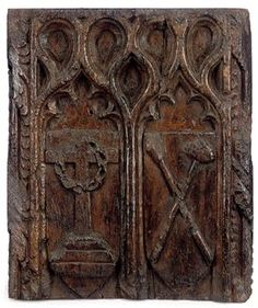 A late-fifteenth/early-sixteenth-century Cornish oak bench-end fragment carved with symbols of Christ's passion. (Christie's)