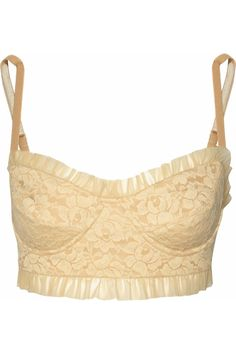 This Norma Kamali lace bustier is a bikini top, but I'd wear it under/with everything!