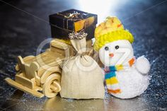 Qdiz Stock Photos | Snowman with wooden car, gift box and sack,  #auto #automobile #background #box #car #celebration #Christmas #classic #closeup #decoration #delivery #doll #eve #figure #fun #funny #gift #gold #greeting #grunge #hat #holiday #light #little #Merry #metal #new #old #present #retro #sack #scarf #silver #small #snowman #surface #toy #traditional #transport #transportation #vehicle #vintage #white #wood #wooden #xmas #year #yellow