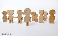 Handmade toy - wooden dolls.    Our toys are safe, ecological, natural and long lasting. Simple design, playful and small size figures are perfect for