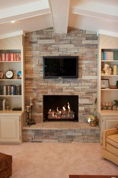 tumbled stone fireplace veneer ideas | chicago stacked stone veneer living room traditional with update fireplace accessories faux
