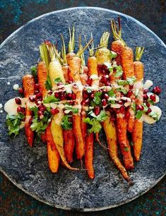 Healthy Thanksgiving Side Dish Idea: Roasted carrots with tahini and pomegranate Sweet and nutty and topped with juicy pomegranate seeds, these are a far cry from your normal roast veggies. This vegan dish will serve four as a side dish. Vegetable Dishes, Vegetable Recipes, Vegetarian Recipes, Cooking Recipes, Healthy Recipes, Fast Recipes, Cooking Food, Roasted Carrots, Baked Carrots