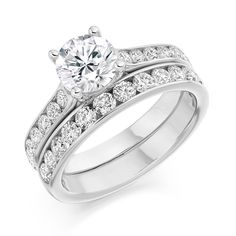 Round brilliant channel set engagement and wedding ring Engagement Rings Channel Set, Design Your Own Engagement Rings, Engagement Rings Round, Perfect Engagement Ring, Designer Engagement Rings, Vintage Engagement Rings, Tiny Stud Earrings, Crystal Earrings, Crystal Jewelry