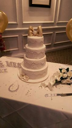 First ever wedding cake   ivory and gold wedding cake
