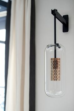 The majestic Vadim wall lamp sports a generous glass body which contrasts with its fine steel rod. Suspended in the air, the perforated cage emits a soft light and projects graphics reflections on the walls. Accent Lighting, Cool Lighting, Modern Lighting, Lighting Design, Pendant Lighting, Lighting Ideas, Bedside Lighting, Office Lighting, Deco Luminaire
