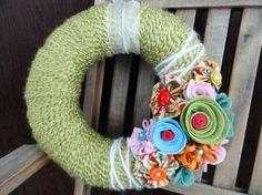 Google Image Result for http://sewcraftalicious.files.wordpress.com/2011/02/yarn-wreath-with-felt-flowers.jpg
