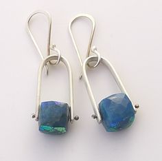 These clean simple sterling silver satin finish stirrups sport faceted chrysocolla cubes with hand crafted ear wires. overall earring length: 35 mm