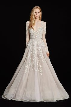 Amethyst long sleeve rococo bridal gown, beaded and embroidered bodice with illusion bateau neckline and V-neck front, full intricate back, tulle skirt with cathedral train. Also available in Ivory.
