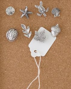Decorative Pushpins  {Whimsical but quiet. These would go perfectly with the classic bulletin board!}