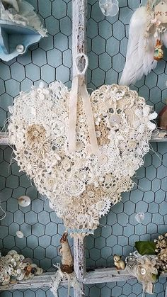 True Love  This gorgeous heart is a Shabby Chic dream of a heart! An abandoned wire hanger was hand tugged and pulled into a not so perfect heart, like our own then wrapped with tattered and torn strips of vintage cream fabric. It was covered with very sheer white netting that